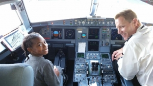 Quan J. gets to meet the pilot and take a tour of the cockpit on the trip to Los Angeles, CA